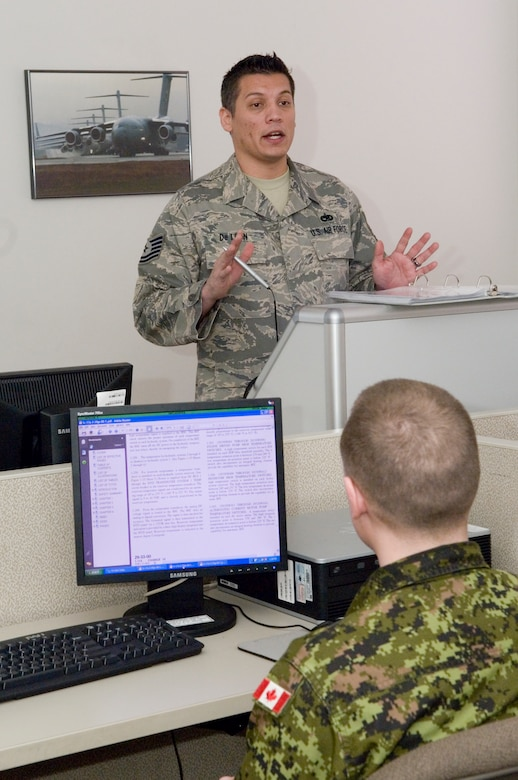 Tech. Sgt. Ed Deleon, 373rd Training Squadron, Detachment 12, lectures Canadian air force maintainers on the C-17 Globemaster III's secondary flight controls during a recent hydraulics class.