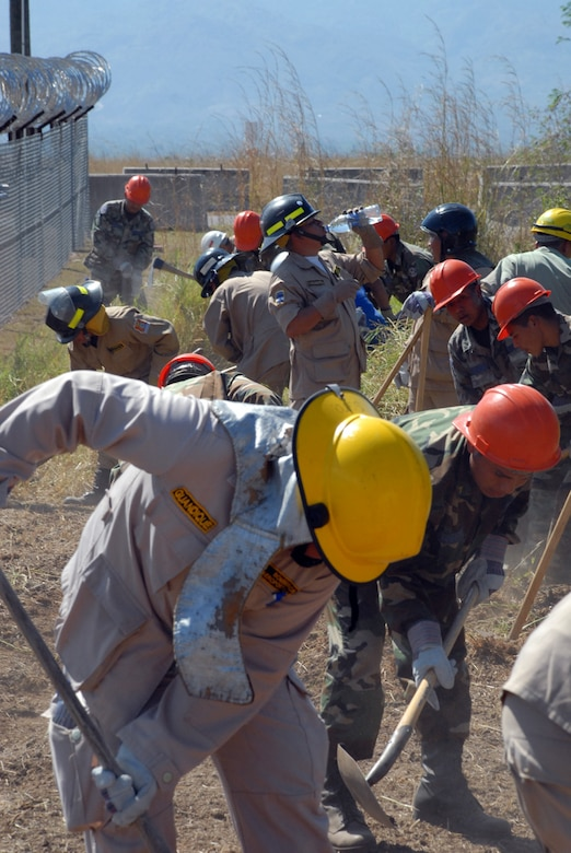 Honduran military and civilian firefighters dig a fire break at Soto Cano Air Base, Honduras. The firefighters are participating in a JTF-Bravo-sponsored firefighting subject matter expert exchange. During the exchange, a learning exposition for U.S. and Honduran firefighters, a great level of importance is placed on land navigation and fighting wildfires. (U.S. Air Force photo by Tech. Sgt William Farrow)