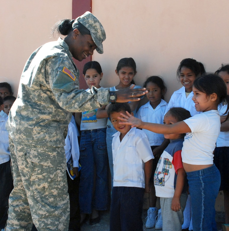 Army Staff Sgt. Tracey Francis, team medic for JTF-Bravo Civil Military Operations, plays with children at Carlos Sanchez School in La Paz, Honduras, Feb. 21. The children later received backpacks packed with school supplies donated by children in the United States. (U.S. Air Force photo by Tech. Sgt John Asselin)