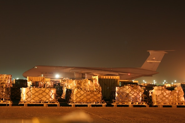 A 445th Airlift Wing C-5 sits on the flightline at Kuwait International Airport. The 445th Airlift Wing began flying regular missions to Kuwait in January, 2008, in support of U.S. forces in Iraq and Afghanistan.  The flights leave Wright Patterson AFB, Ohio, load cargo at an East Coast base, then fly into Ramstein AB, Germany.  The plane then heads to Kuwait and makes its way back to Wright-Patt. (U.S. Air Force photo/Maj. Ted Theopolos)