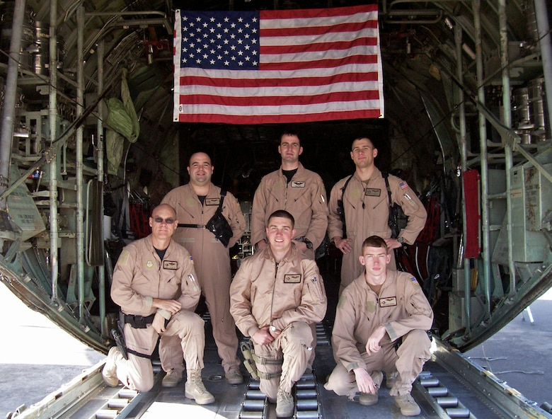 SOUTHWEST ASIA -- A 737th Expeditionary Airlift Squadron crew out of Pope Air Force Base, N.C. flew a medevac mission Jan. 31, 2008 in support of Operation Iraqi Freedom which helped save the life of a 13-month-old Iraqi boy injured by an improvised explosive device attack in southern Iraq which claimed the lives of both his parents. The aircrew, (top row left to right) Capt. Jeff Noble, aircraft commander, Capt. Neil Hoy, co-pilot, Capt. Nathan Preuss, navigator, and (bottom row left to right) Senior Master Sgt. J.R. Miller, engineer, Senior Airman Chase Cantrell and Airman 1st Class Ross Hagen, loadmasters, recently returned home from their deployment to a Southwest Asia air base in support of the Global War on Terror. Their mission while deployed was to transport cargo and passengers throughout the deployed theater. (Courtesy photo)