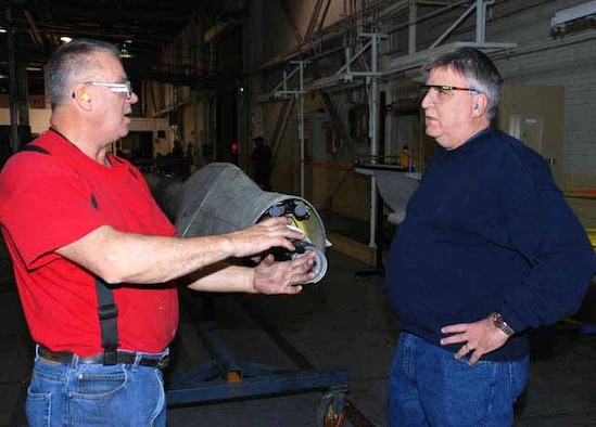 DSCR forward presence customer account specialist Joe McRoy (right) talks with aircraft mechanic Joe Cram about work on a refueling boom for a tanker at Oklahoma City Air Logistics Center. McRoy works commodities issues for DLA's largest aviation customer. (Photo by Debra Bingham)
