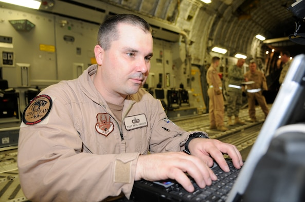 Tech Sgt. Paul D. Hagood, 379th Expeditionary Communications Squadron, monitors the Viper system while on a C-17 at a Southwest Asia air base Feb 19. Sergeant Hagood is able to monitor the aircraft position, signal strength, and equipment status. He is deployed from Schriever Air Force Base, Colo. (U.S. Air Force photo/Tech. Sgt. Johnny L. Saldivar)