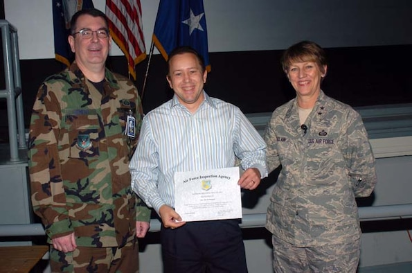 From left, Lt. Col. Robert Bement, UCI Inspection Team Chief; Dave Bennett from the Air Force Personnel Center; and Maj. Gen. K.C. McClain, AFPC commander, pose after Mr. Bennett received a Superior Performer certificate. He heads the government purchase card program at AFPC, which received an outstanding rating. (U.S. Air Force photo/File)