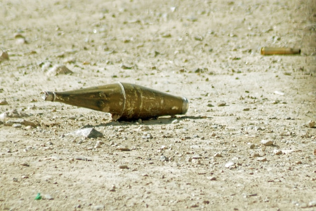 A rocket propelled grenade lays unexploded on the ground after bouncing off a Humvee in a Helmand Province village during late February. A Taliban fighter had just shot the RPG at a Marine Special Operations Company's Marines in the southern Afghanistan village. Photo by Marine Staff Sgt. Luis P. Valdespino Jr.