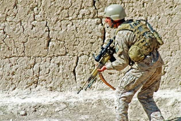 A Marine with a Marine Special Operations Company patrols a village looking for Taliban fighters who attacked the MSOC unit and Afghan National Army soldiers in the Helmand Province village. ANA soldiers and MSOC Marines were visiting the southern Afghanistan village when they were attacked by Taliban fighters in late February. Photo by Marine Staff Sgt. Luis P. Valdespino Jr.