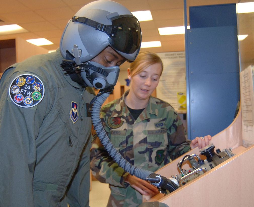 Airman 1st Class Natasha Sanders, 41st Flying Training Squadron, helps Tech. Sgt. Anthony Fleming, 332nd Recruiting Squadron, check the pressure in his mask before his T-6 flight Tuesday. (U.S. Air Force photo by Airman 1st Class Danielle Hill)