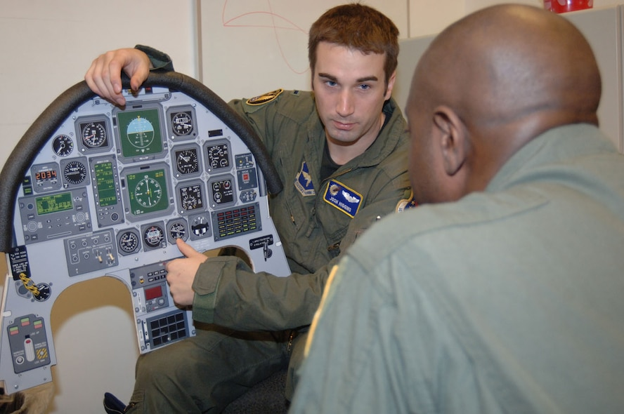 Second Lt. Joshua Higgins, 41st Flying Training Squadron, briefs Tech. Sgt. Anthony Fleming, 332nd Recruiting Squadron, before their T-6 flight Tuesday. Sergeant Fleming was named the top recruiter for 2006 and 2007 in eastern Tennessee. (U.S. Air Force photo by Airman 1st Class Danielle Hill)