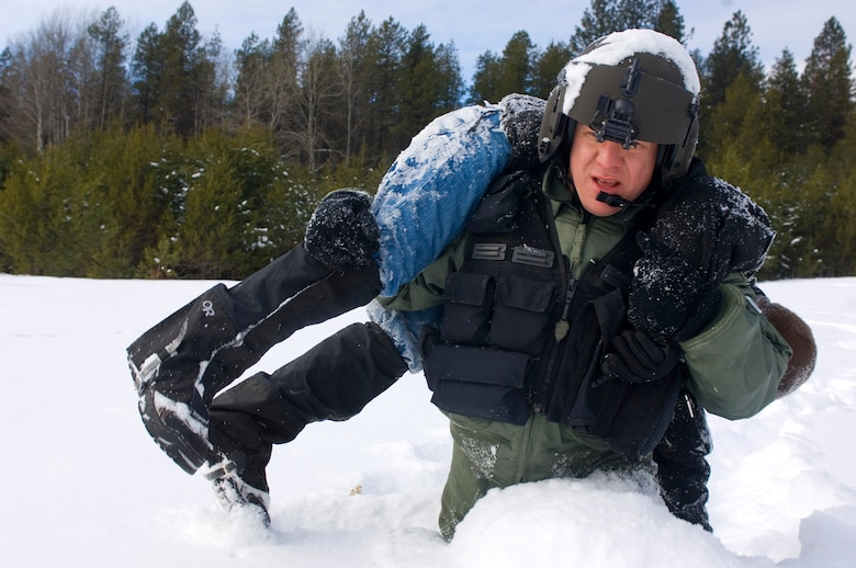 Resistance training? Much like in this training scenario, Staff Sgt. Jason Weiss had to carry a 176-pound man through waist-deep snow during a december rescue. (Air Force photo by Tech. Sgt. Matthew Hannen)