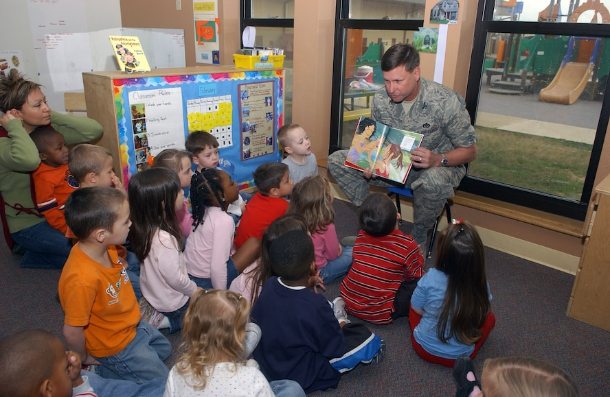 """Brig. Gen. Len Patrick, 37th Training Wing commander, reads the book """"Hands!"""" to a group of children at the Lackland Child Development Center on Feb. 19. The event was sponsored by the African American Heritage Committee. (USAF photo by Alan Boedeker)"""