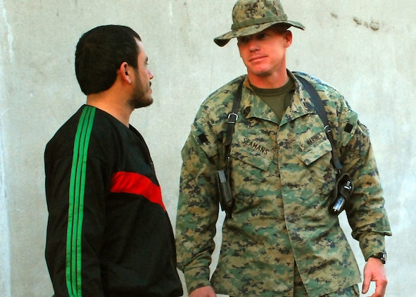 Afghan National Army Sgt. Maj. Shamoor Hamidi (left), and Marine 1st Sgt. Matthew S. Seamans, of Shorewood, Minn., discuss ANA issues regarding an upcoming convoy in eastern Konar Province, Afghanistan. Hamidi is the kandak sergeant major for 3rd Kandak (Armored), 3rd Brigade, 201st ANA Corps. Seamans is an embedded training team mentor deployed to Afghanistan from Okinawa, Japan, to work with the ANA. Photo by Marine Staff Sgt. Luis P. Valdespino Jr.