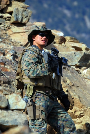 Petty Officer 1st Class Reynaldo S. Datu patrols on a mountain in eastern Konar Province, Afghanistan, with his Marine embedded training team and soldiers from the 3rd Kandak (Armored), 3rd Brigade, 201st Afghan National Army Corps. Datu is part of ETT 7-2, which is deployed to Afghanistan from Okinawa, Japan, to work with the ANA. He is the only sailor based out of Forward Operating Base Naray, Afghanistan. Photo by Marine Staff Sgt. Luis P. Valdespino Jr.