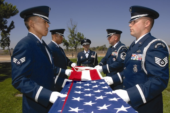 U.S. Air Force members of the Blue Eagles Total Force Honor Guard team practice their funeral services routine at March Air Reserve Base on August 8. The Blue Eagles Total Force Honor Guard has been performing services for Southern California since 1997. (U.S. Air Force photo by Staff Sergeant Eduardo Cervantes)