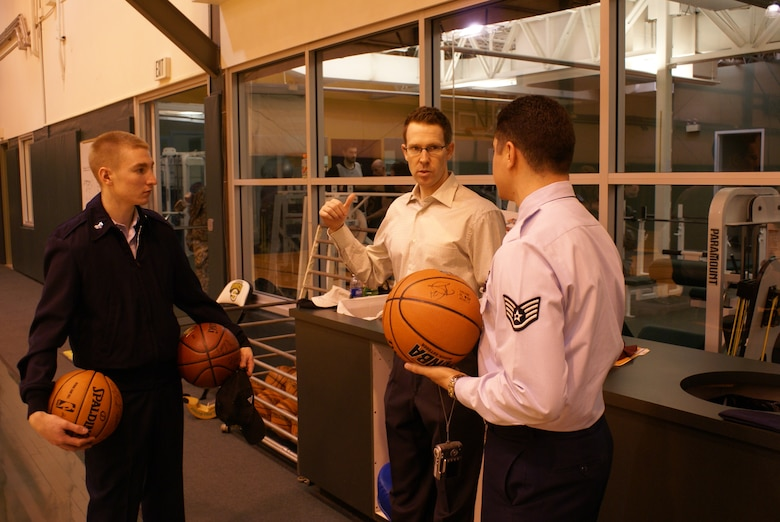 Sonics general manager Sam Presti, center, talks basketball with Senior Airman Troy Bame, 62nd Operations Support Squadron, left, and Sergeant Tercero. (Photos by Tyler Hemstreet.)