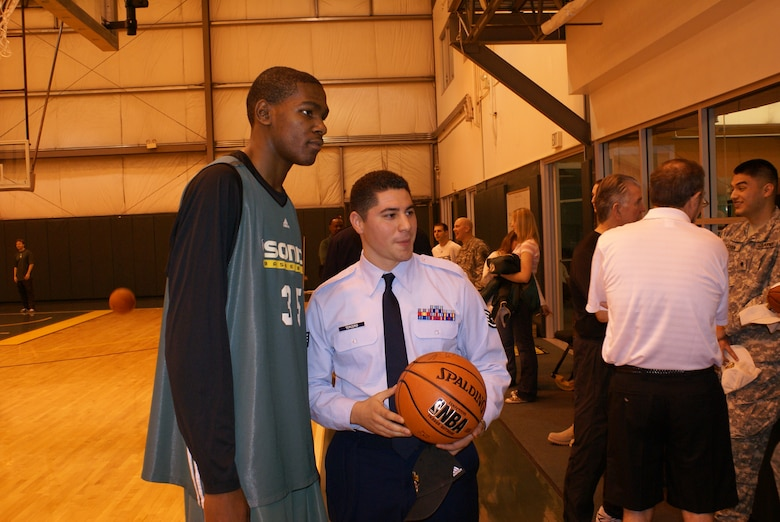 Staff Sgt. Daniel Tercero, 22nd Special Tactics Squadron, poses for a picture with Sonics rookie Kevin Durant.