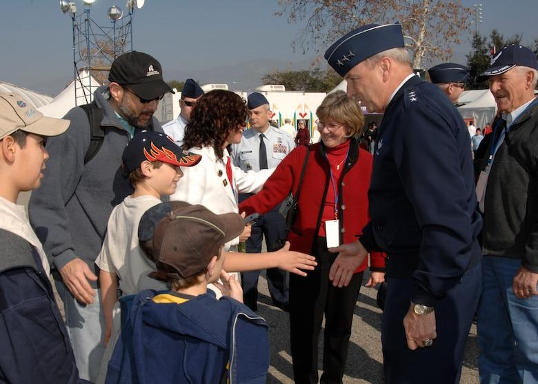 Lt. Gen. Michael Hamel, Space and Missile Systems Center commander, greets children attending the Fanfest, a pre-Tournament of Roses Parade event held at the Pasadena Rose Bowl stadium parking area, Dec. 30. (Photo by Joseph Juarez)