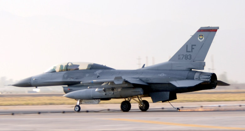 The tailhook of a 63rd Fighter Squadron F-16 scrapes along the runway before grabbing hold of the arresting barrier Dec 20. The barrier engagement is an annual requirement airfield managers must arrange and perform to ensure the systems are operational. (U.S. Air Force photo/Tech. Sgt. Raheem Moore)