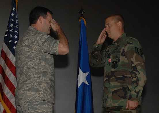 Staff Sgt. Ronald White, 36th Civil Engineer Squadron, salutes Brig. Gen. Douglas Owens, 36th Wing commander, after receiving the Bronze Star Medal Dec. 21 for performing outstanding service as an Explosive Ordnance Disposal team leader in the 332nd EOD Flight, Logistics Support Area Anaconda, from Jan. 7 to June 25, 2007 in support of Operation Iraqi Freedom. (U.S. Air Force photo/Senior Airman Sonya Padilla)