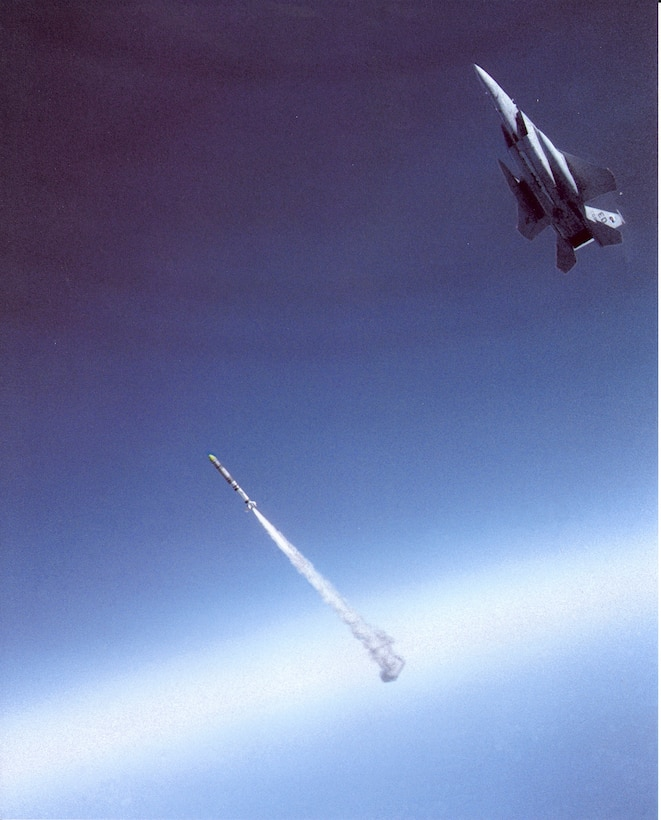 "Maj. Wilbert ""Doug"" Pearson successfully launched an anti-satellite, or ASAT, missile from a highly modified F-15A Sept. 13, 1985 over Edwards Air Force Base, Calif. He scored a direct hit on a satellite orbiting 340 miles overhead. (Courtesy photo illustration)"