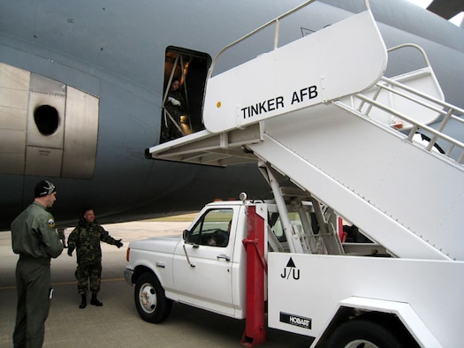 Members of the 72nd Aerial Port Squadron, 507th Air Refueling Wing, Air Force Reserve Command, practice maneuvering a staircase truck to the C-5 Galaxy parked on the ramp at Tinker AFB, Oklahoma, to train on procedures for safe loading and unloading of passengers.