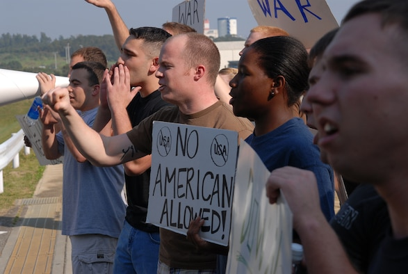 Protesters shout during a simulated protest during Local Operational Readiness Exercise Beverly High 08-3 at Kadena Air Base, Japan, Jan. 7, 2007. The 18th Wing conducted the exercise from Jan. 7 to 11 to test Airmen's ability to respond in contingency situations. (U.S. Air Force photo/Tech. Sgt. Dave DeRemer)