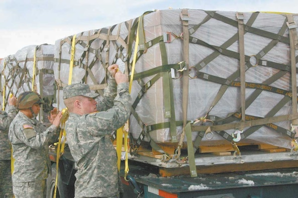 Nevada National Guard Soldiers unload two pallets of MREs (Meals Ready to Eat) for the more than 3,000 displaced residents of Fernley, Nev., Jan. 6. The town of Fernley (located about 30 miles east of Reno) was flooded with icy water when a levee holding back the Truckee canal gave way Jan. 5 after a severe winter storm. About 50 Guardmembers in the state have been activated to help with the storm damage. Photo by Lt. Col. Steve Ranson, Joint Forces Headquarters, Nevada Army National Guard.