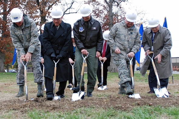 From left: Lt. Gen. Craig McKinley, director of the Air National Guard; retired Lt. Gen. John Conaway, former chief of the National Guard Bureau; Col. Joe Lengyel, ANGRC commander; Air Guard Command Chief Master Sgt. Richard Smith; and J.L. Herndon of Clarke Construction break ground on an ANGRC expansion project Nov. 19 at Andrews Air Force Base, Md. (Photo by Tech. Sgt. Mike R. Smith, National Guard Bureau)