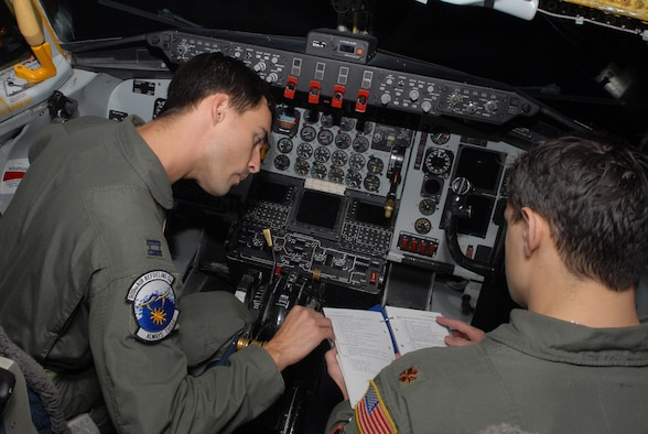 Capt. Denique Asion, and Maj. Michael Kallai, 909th Air Refueling Squadron, go through a KC-135 Stratotanker check list prior to takeoff during a simulated aircrew extraction scenario, during Local Operational Readiness Exercise Beverly High 08-3 at Kadena Air Base, Japan, Jan. 9, 2007. The 18th Wing conducted the exercise from Jan. 7 to 11 to test Airmen's ability to respond in contingency situations. (U.S. Air Force photo/Staff Sgt Chrissy FitzGerald)