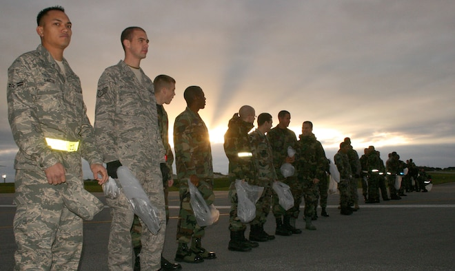 About 500 servicemembers get on line to search for debris on the two runways at Kadena Air Base, Japan, during the annual FOD Walk Jan. 3, 2007. More than 500 others cleaned their units' maintenance areas and parking lots at the same time. (Stars and Stripes photo/Cindy Fisher)