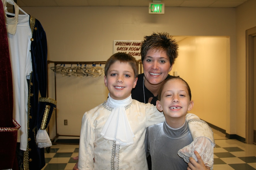 Melanie Davis with her two children Ryan (left) and Zoe backstage at the Space Coast Ballet.
