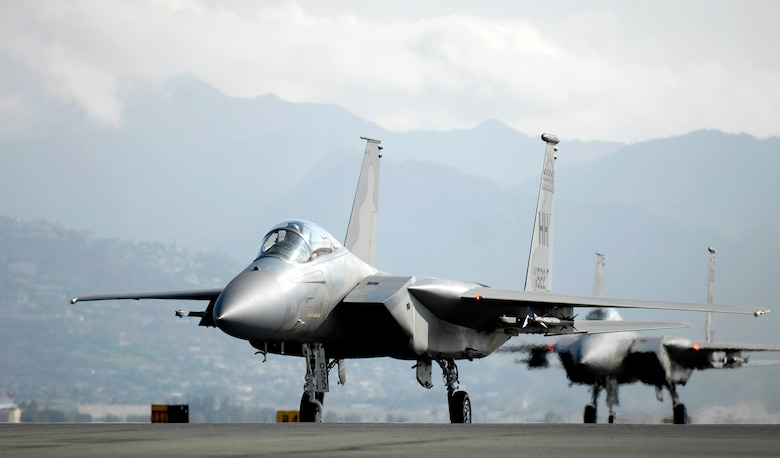 F-15 Eagles taxi on the flightline after flying a mission Jan. 9 at Hickam Air Force Base, Hawaii. The F-15s, from the 199th Fighter Squadron of the Hawaii Air National Guard, have not flown since Air Force officials grounded the F-15 fleet Nov. 3, 2007. Air Combat Command officials cleared a portion of its F-15 A through D models to begin flying today. (U.S. Air Force photo/Tech. Sgt. Shane A. Cuomo)