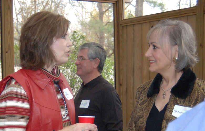 Susan Dunn, wife of Col. Jeff Dunn, 14th Flying Training Wing vice commander, talks with Burnette Avakian, owner of Shadowlawn, Saturday during the New Year's reception hosted by Col. Dave Gerber, 14th FTW commander, and his wife Lousia.