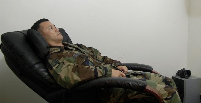"Staff Sgt. Max Pontenilla, 36th Services Squadron Fitness Program NCOIC, demonstrates the massage chair in the Relaxation Room at Andersen Air Force Base Health and Wellness Center. The HAWC is offering a variety classes in observance of ""Healthy Weight Month."" (U.S. Air Force photo/Master Sgt. Lisa Zunzanyika)"