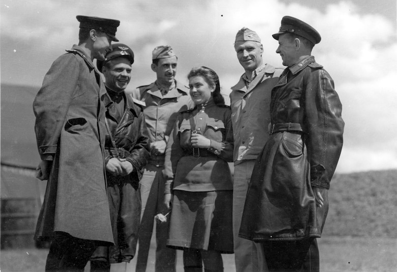 Russian officers chat with Col. Barton, commanding officer of the 483rd Bomb Group, and Col. Rice of the 2nd Bomb Group at Mirgorod. The girl in the center is an interpreter. (U.S. Air Force photo)