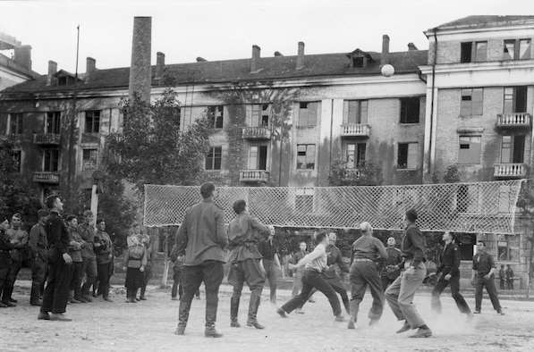 The Soviets turned out to be expert volleyball players, and every night in the courtyard of Eastern Command HQ at Poltava, there were fast mixed games. Player fifth from the right at bottom is Gen. Ira Eaker. (U.S. Air Force photo)