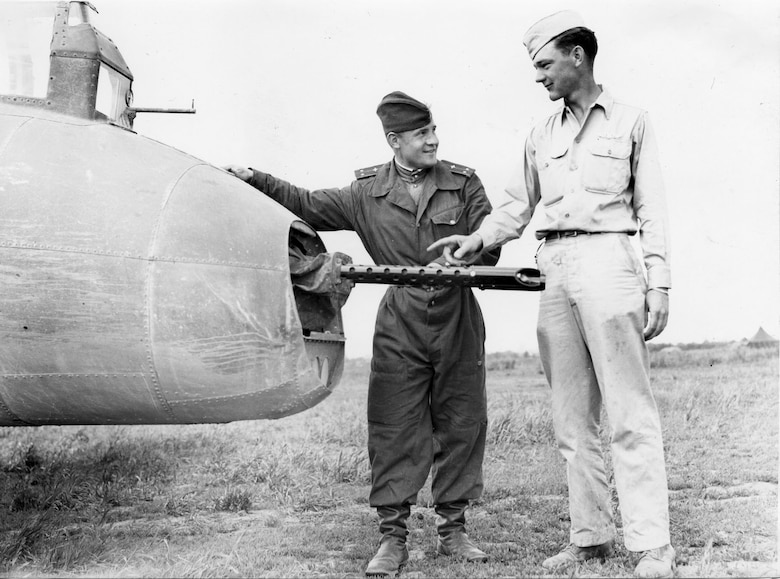 Lt. Vorokev of the Soviet Air Force inspects the tail gunner position of SSgt. Thomas Summers' B-17 Flying Fortress. (U.S. Air Force photo)