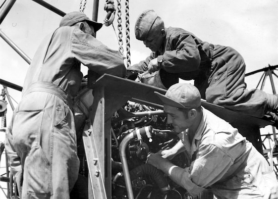 MSgt. John M. Bassett, Lenin Boykov of Leningrad, and MSgt. Michael Cajolda service a visiting task force bomber. (U.S. Air Force photo)