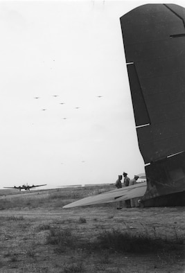 97th and 99th Bomb Group B-17s return to Amendola Airfield, Italy, from the first shuttle mission to Russia. Gen. Ira Eaker's C-35 awaits him at right, June 11, 1944. (U.S. Air Force photo)