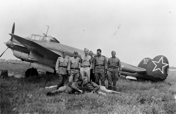 Russian pilots and ground crew stand in front of a Petlyakov Pe-2 light bomber at Poltava, Russia, during the first shuttle raid -- Italy to Russia and return -- in June 1944. GI is TSgt. Bernard J. McGuire, Tonawanda, N.Y., of the 348th Bomb Squadron, 99th Bomb Group. (U.S. Air Force photo)