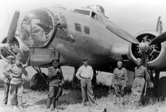 Badly damaged B-17 bomber and Russian soldiers in Poltava, Russia, on June 22, 1944. (U.S. Air Force photo)