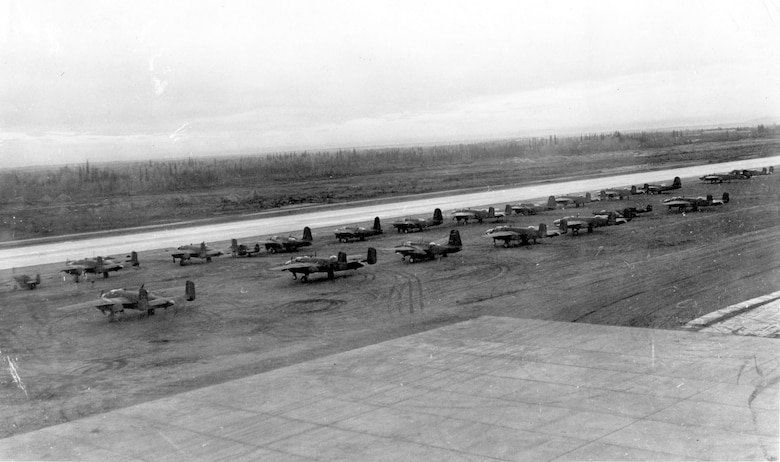 Lend-lease B-25s and P-39s on the runway at Ladd Field, Alaska, prior to testing by the Soviet Purchasing Commission, September 1942. (U.S. Air Force photo)