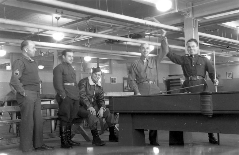 American and Soviet airmen pose during a game of billiards. This photo was taken in Alaska during American-Soviet lend-lease operations. (U.S. Air Force photo)
