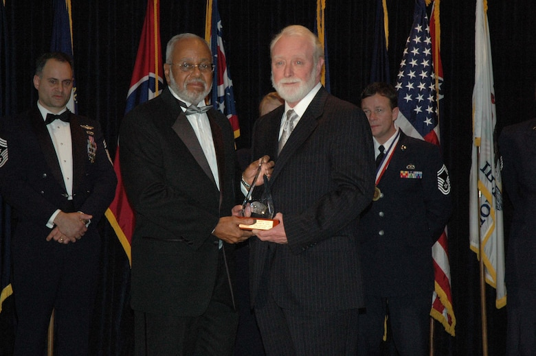 MCGUIRE AIR FORCE BASE, N.J. -- Retired Chief Master Sgt. Donald W. Ivins, right, receives the Joseph McNeil Award from Maj. Gen. Joseph A. McNeil (Ret.) in whose name the award was named, Jan. 12, during the 8th annual awards banquet at the 514th Air Mobility Wing. As a key contributor to the civil rights movement in 1960, General McNeil's life example of citizenship and service to others is part of the criteria selection the award is based upon. (U.S. Air Force photo/Senior Airman William P. O'Neil III)