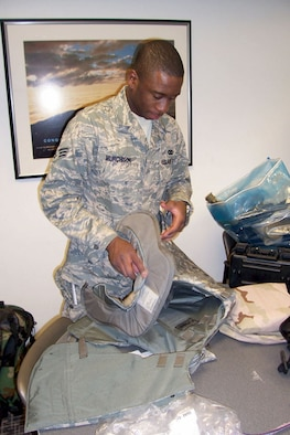 SrA Chris Murchison, 507th Air Refueling Wing Security Forces Squadron, makes some final adjustments on his flak vest in preparation for deployment to Iraq. Airman Murchison and approximately 40 fellow Air Force Reservists from Tinker Air Force Base, Oklahoma, are deploying.