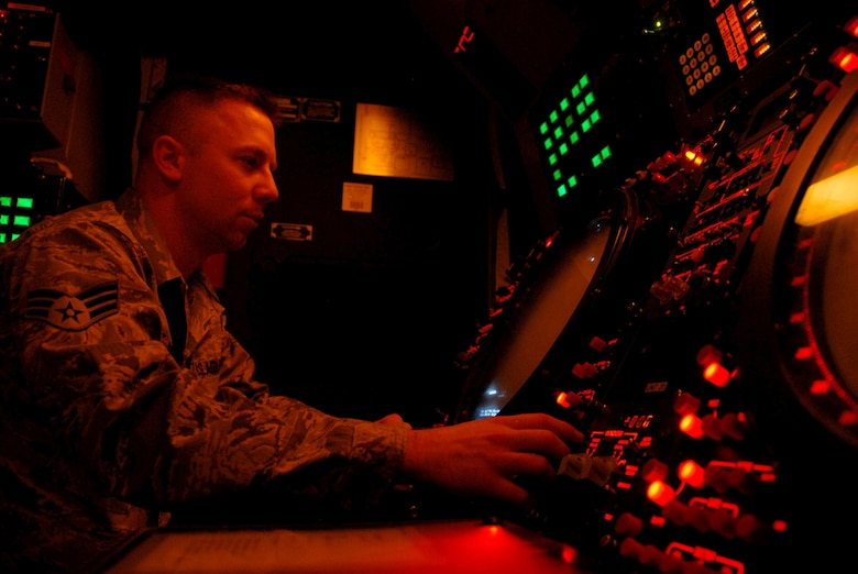 Senior Airman William Reid, 607th Air Control Squadron radar maintenance technician, looks for critical radar data on a scope inside the operations module.The 607th is a tennant unit of Luke, and conducts initial qualification training for operations crew personnel assigned to ACSs.