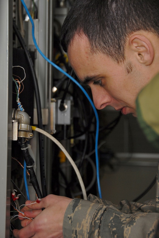 Staff Sgt. James Smith, 607th Air Control Squadron ground radio technician, installs cable for the multiplexer at the White Tank Mountains. The 607th is a tennant unit of Luke, and conducts initial qualification training for operations crew personnel assigned to ACSs.