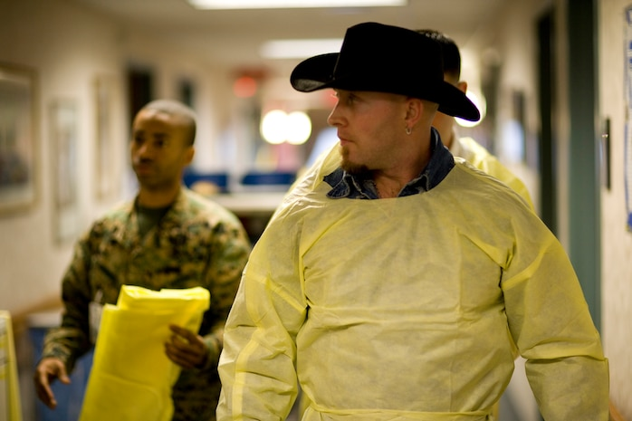 """BETHESDA, Md. – Country singer John Kiger gets suited up to visit with a wounded service member. """"I don't look up to many people, but I put these guys on a pedestal,"""" said Kiger. Kiger, along with Veterans of Valor, visited Bethesda Naval Hospital and Walter Reed Army Medical Center January 17 to give backpacks and words of encouragement to wounded service members.::n::Photo by Staff Sgt. Leo A. Salinas::n::"""