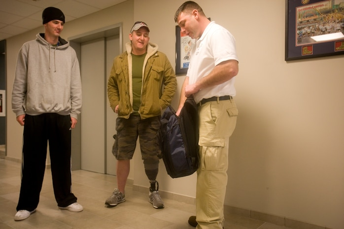 BETHESDA, Md. – Cpl. Jimmy Kinsey receives his backpack from Sgt. Klay South, founder of Veterans of Valor. Veterans of Valor visited Bethesda Naval Hospital and Walter Reed Army Medical Center January 17 to give backpacks and words of encouragement to wounded service members.::n::Photo by Staff Sgt. Leo A. Salinas::n::
