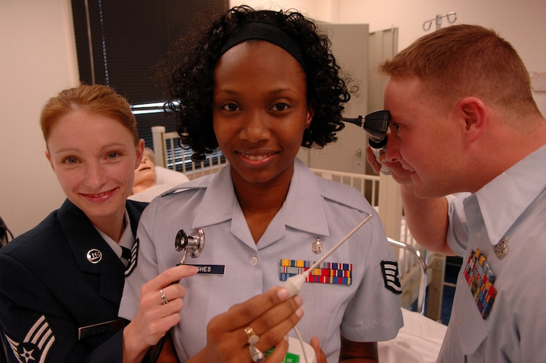 From left, Staff Sgts. Jacqlyn Sanchez, Crystal Hughes and Michael Jessup, all selected for the Nurses Enlisted Commissioning Program (NECP), make the change from Moody Air Force Base to Valdosta State University. The NECP is a program for enlisted Airmen to become commissioned nurses while maintaining active duty status. (U.S. Air Force photo by Airman 1st Class Gina Chiaverotti)