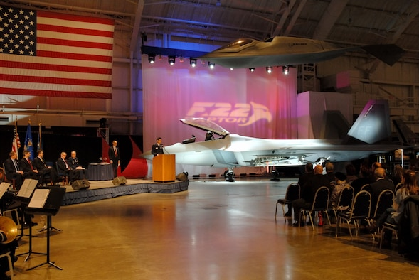 DAYTON, Ohio (1/17/08) - Brig. Gen. C.D. Moore, Commander, 478th Aeronautical Systems Wing at Wright-Patterson Air Force Base, addresses the crowd during the F-22A Raptor exhibit opening ceremony at the National Museum of the U.S. Air Force. Seated on stage (from left to right) are Mr. Chris Flynn, Director of the F119 Program for Pratt & Whitney; Mr. Paul J. Bay, Vice President and Program Manager of the F-22 Program for the Boeing Company; Mr. Larry Lawson, Executive Vice President and General Manager of the F-22 Program for Lockheed Martin; Maj. Gen. (Ret.) Charles D. Metcalf, Director of the National Museum of the U.S. Air Force; and Lt. Gen. Frank G. Klotz, Assistant Vice Chief of Staff and Director of Air Force Staff.  (U.S. Air Force photo)